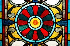 A closeup of a stained glass window. A closeup of an old stained glass window from the 1890`s royalty free stock photo