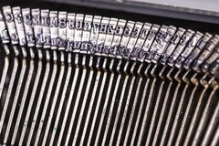 Closeup of old typewriter letters Royalty Free Stock Photos