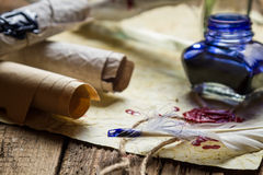 Closeup of old vintage desk full of scrolls scribe royalty free stock images