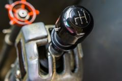 Closeup of a old vintage gear shift stick, interior of a retro bus. A closeup of a old vintage gear shift stick, interior of a retro bus royalty free stock photography