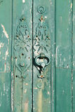 Weathered green door Stock Image