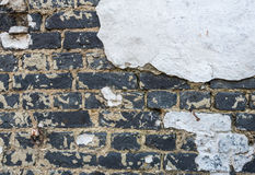 Closeup of an old white plastered brick wall Royalty Free Stock Photo