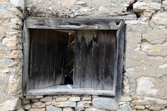 Old wooden window on stonewall stock images