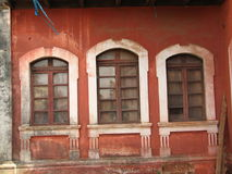 old window with terra-cotta tiled roof. An architectural details from Goa, India. stock photography