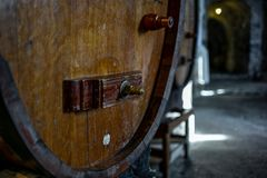 Closeup of an old wine barrel in a cellar in Switzerland. 1 stock photography
