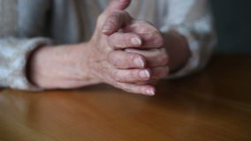 Closeup of old woman's hands on table moving nervously stock footage