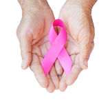 Closeup Old woman hand holding pink ribbon on white background , stock images
