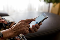 Closeup of old woman hands holding mobile phone Royalty Free Stock Images