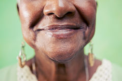 Closeup of old woman mouth against green background royalty free stock photo
