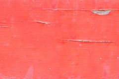Closeup of old woodboard texture painted on red Stock Photo