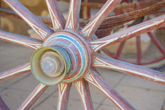 Closeup of old wooden carriage wheel Royalty Free Stock Photo