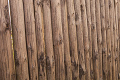 closeup old wooden fence of logs in form of palisade Royalty Free Stock Photo