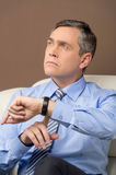 Closeup of older man looking at watch. Royalty Free Stock Photo