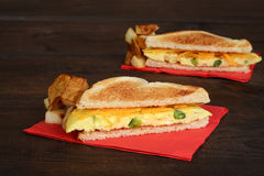 Closeup omelette sandwich with fries Stock Photography