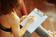 Free Closeup On Fit Woman With Clipboard Filling Meal Plan Stock Image - 144827481