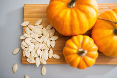 Free Closeup On Small Pumpkins And Seeds On Table Stock Image - 50649191