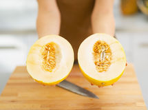 Free Closeup On Two Slices Of Melon In Hand Of Woman Stock Image - 33196131