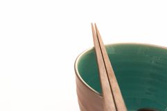 Closeup of One Bowl with Chopsticks. On White Background stock photography