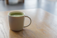 Closeup one  cup of hot Green Tea on clean wooden table in morni Stock Image