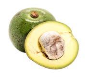 Closeup one and half of green thai avocado on white background. Close up one and half of green thai avocado on white background stock photos
