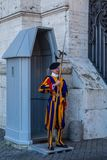Closeup of one male Swiss guard with traditional uniform on duty guarding an entrance in the Vatican in Rome. ROME, ITALY - APRIL 21, 2015: Closeup of one male royalty free stock photo