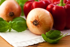 Closeup of onions,peppers and fresh basil Royalty Free Stock Photo
