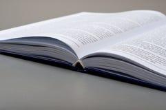 Closeup open book on a gray table Stock Image