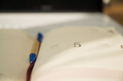 Closeup open book with pen lying in the middle.  stock photo
