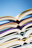 Closeup of Open Books. Stack of nicely arranged open books or textbooks with copy space. An image about school and education Royalty Free Stock Images
