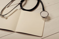 Closeup open notebook with blank pages with stethoscope Royalty Free Stock Image