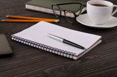 Closeup open notepad with blank pages and pen Stock Photo
