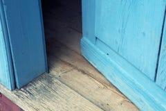 Closeup of open old blue wooden door Stock Photos