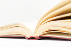 Closeup open old books against a light beige background Royalty Free Stock Image