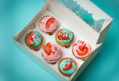 Closeup of open paper box with six colorful cupcakes. Closeup photo of open paper box with six colorful cupcakes Stock Photo