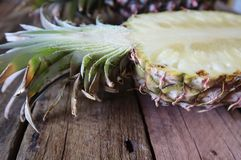 Closeup of Open Pineapple Half on Wooden Background stock images