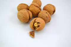 Closeup of open walnut shell. Closeup of dry fruit walnut with shell broken showing fruit inside Stock Photos