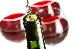 Closeup of opening green wine bottle. On white background Royalty Free Stock Photo