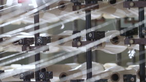 Closeup Operating Spinning Machine with White Thread Bobbins stock footage