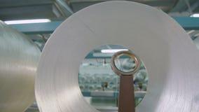Closeup optical fiber unwinds passing through ring stock video footage