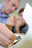 Closeup optician holding tinted lens Royalty Free Stock Photography