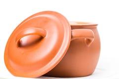 Closeup of orange clay pot. Royalty Free Stock Images