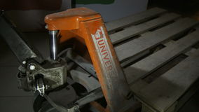 Closeup orange dirty powerful forklift holds wooden pallets stock video footage