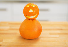 Closeup on orange with funny face Stock Photography
