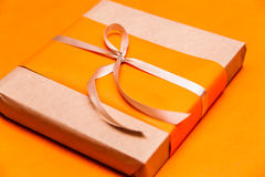 Closeup orange gift box Royalty Free Stock Image