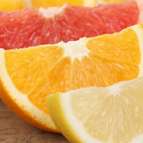 Closeup of orange, lemon and grapefruit fruits Royalty Free Stock Photo