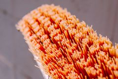 Closeup orange old cleaning brush bristle. Looks as interesting texture and abstract feeling royalty free stock photography