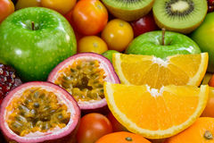 Closeup orange and passion fuits slice with group of ripe fruits Royalty Free Stock Images