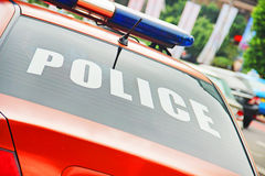 Closeup of the orange police car with a sign POLICE Royalty Free Stock Images