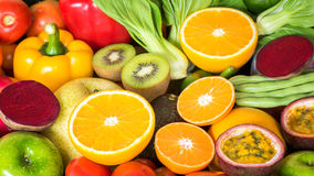 Closeup orange slice with group of fresh fruits and vegetables Stock Image