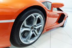 Orange sportscar. Closeup of a orange sportscar Royalty Free Stock Photos